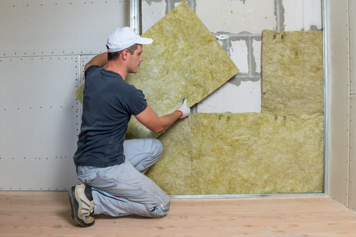 home insulation services specialist installing insulation